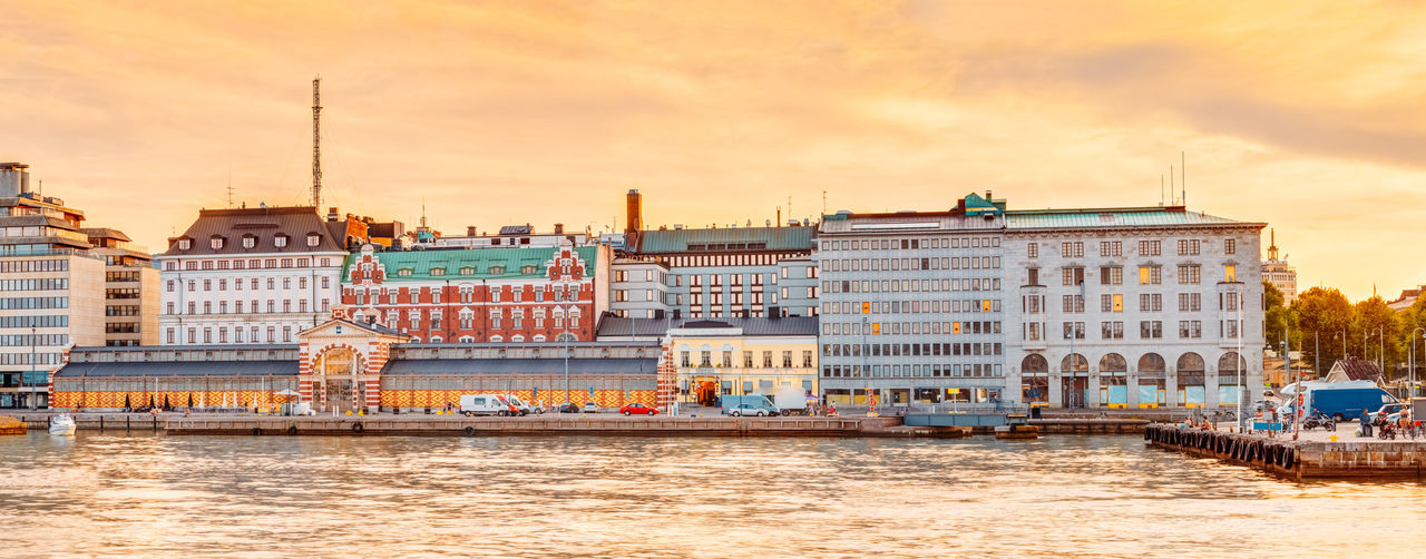 Panorama Of Embankment In Helsinki At Summer Sunset Evening, Sunrise Morning, Finland. Town Quay, Famous Place City EyeEmNewHere Helsinki Market Sunset_collection Travel Travel Photography Trip Architecture City Cloud - Sky Embankment Europe Finlnd Old Outdoors Sky Street Summer Sunrise Sunset Tourism Town Travel Destinations