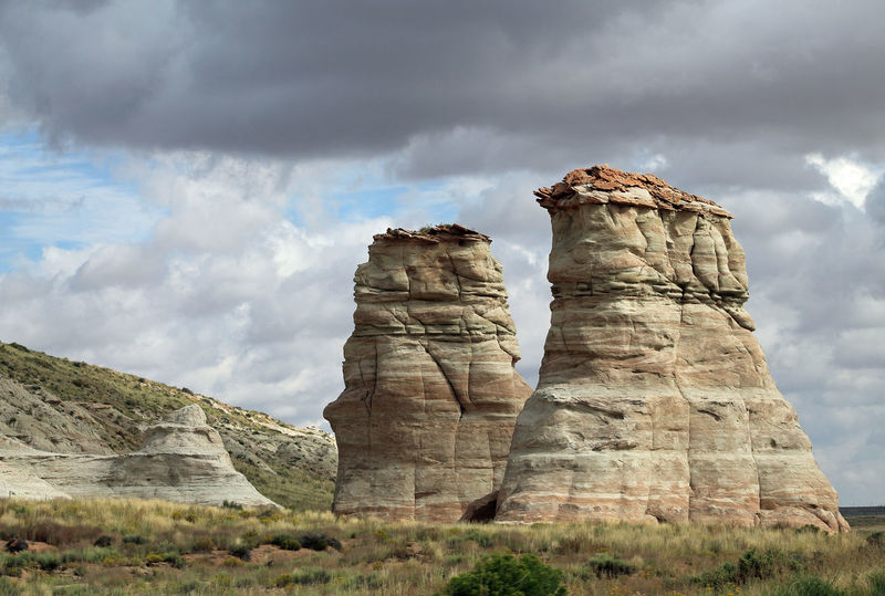 Hoodoos along the highway in Arizona American Southwest Arizona Clouds Desert Hoodoo Scenery Scenic Deserts Around The World