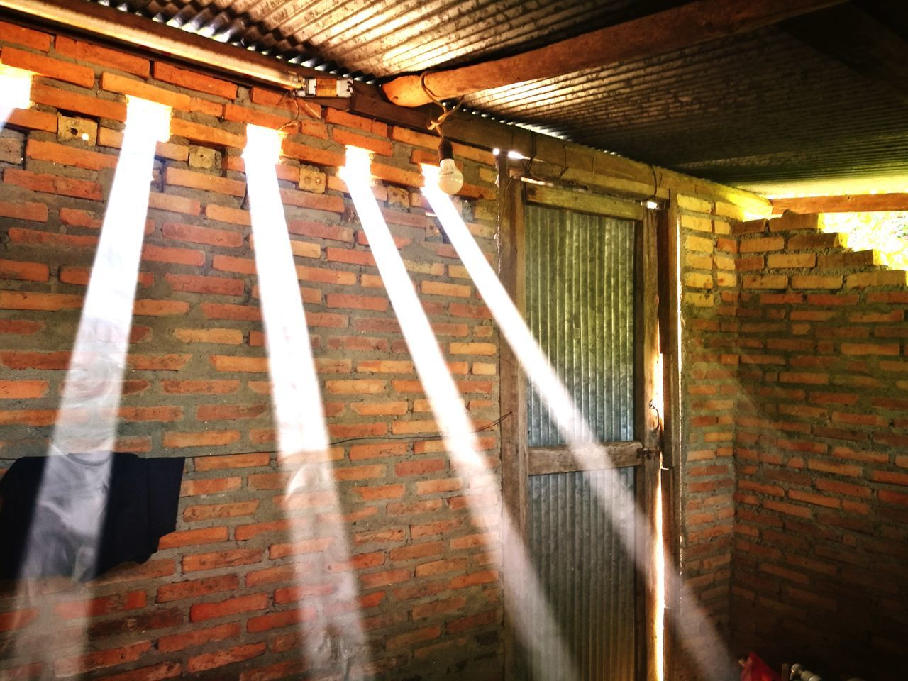 brick wall, architecture, indoors, built structure, illuminated, no people, day