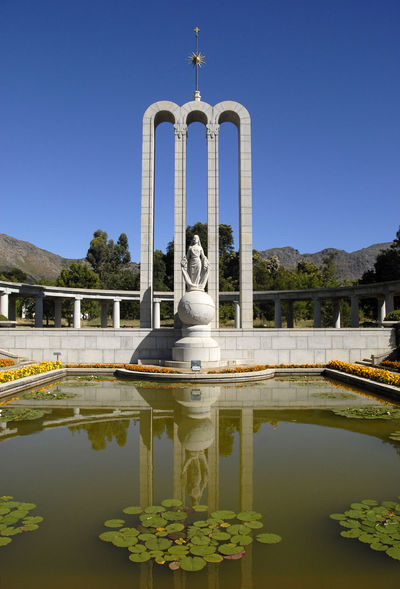 Long shot of Huguenot Memorial, Franschhoek, South Africa Art Blue Day Franschhoek Huguenot Memorial Museum Huguenot Monument Nature No People Outdoors Plant Reflection Sky South Africa Standing Water Travel Destinations Water