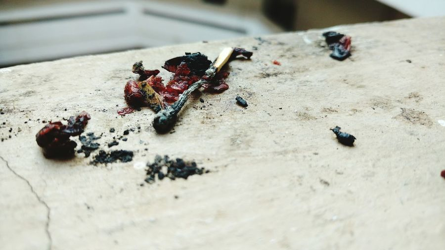High Angle View Of Burnt Matchstick On Table