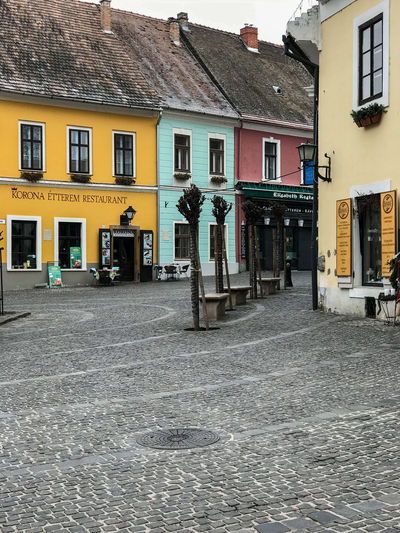 Colorful buildings in Szentendre, Hungary Architecture Building Building Exterior Built Structure City Cobblestone Day House Incidental People Nature Outdoors Real People Residential District Road Street Transportation Water Window