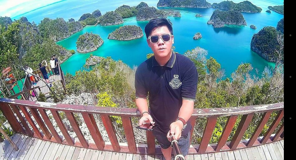 Rajaampat Indonesia Asianman Sea And Sky Nature EyeEmNewHere Travelingindonesia Travelphotography Travelgram Front ViewTravelingram Wonderful Indonesia Pesonaindonesia Photooftheday Picoftheday Potraitphoto Outdoors Vacations Quality Time One Person Standing Day Real People People Young Adult Lifestyles
