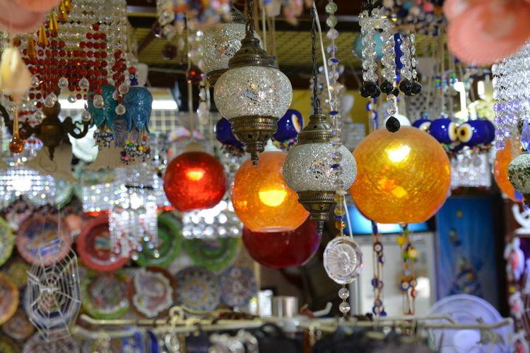 Close-up of illuminated lanterns hanging in store