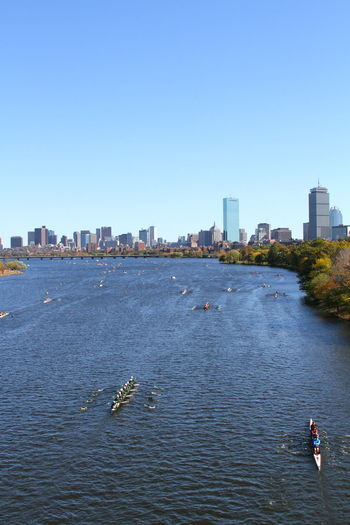 Boston Charles River City Cityscape Day Head Of The Charles Leisure Activity Nature Outdoors People Race Regatta Rowing Sky Skyscraper Sport Urban Skyline Water Waterfront