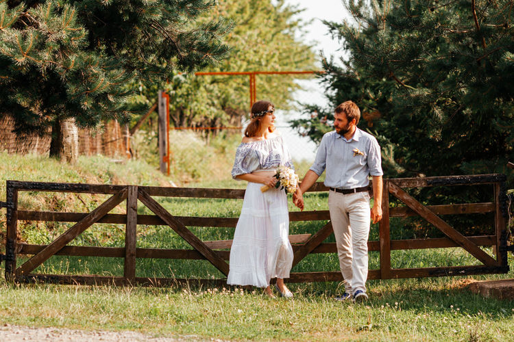 Full length of a young couple on grassland
