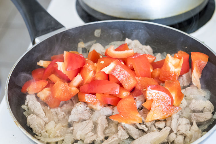 Cuban cuisine: pork tip steak with red peppers cooking in a pan. Close-up Cooking Cool Die Food Freshness High Protein Kitchen No People Panorama Pork Portrait Protein Real Life Still Life Tip Stea