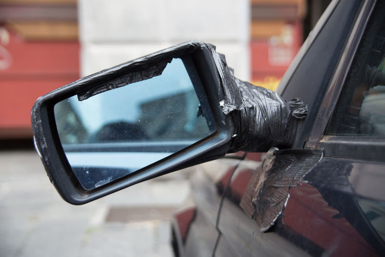Close-up of reflection on side-view mirror
