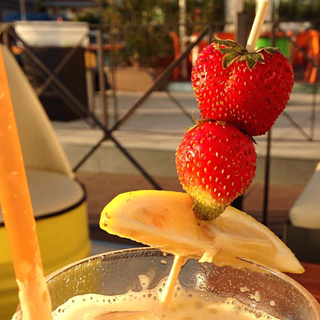 Close-Up Of Strawberries And Sweet Lime On Toothpick In Glass