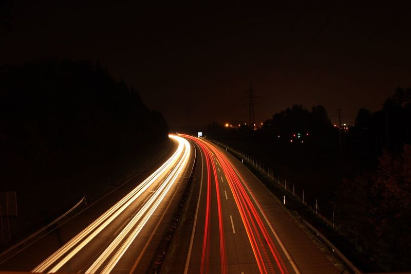 Long Exposure Illuminated Light Trail Road Motion Transportation Night Speed Highway Traffic Blurred Motion Architecture No People Headlight The Way Forward Street Mode Of Transportation City Tail Light City Life 10 Summer Road Tripping