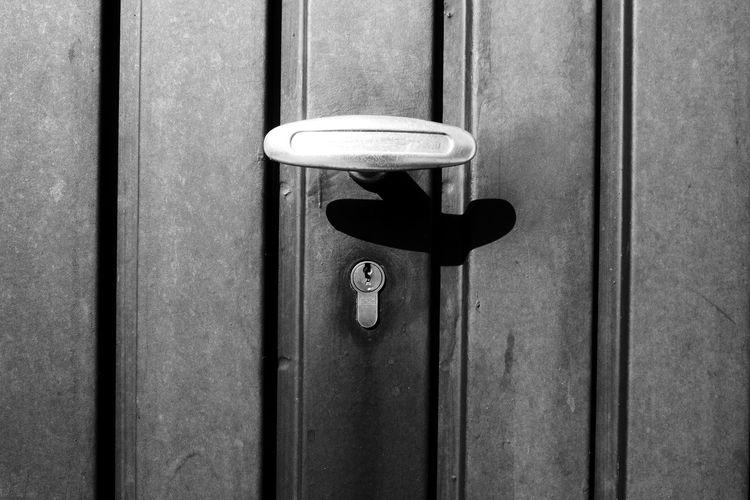 Close-up of doorknob over keyhole