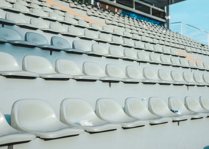 Abstract Architectural Feature Arrangement Blue Building Chairs Day Design Empty Places Geometry In A Row Low Angle View Modern No People Outdoors Pattern Repetition Seats Shapes Side By Side Sky Sports Sports Photography Stadium White
