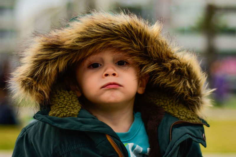 Close-up portrait of boy wearing warm clothing