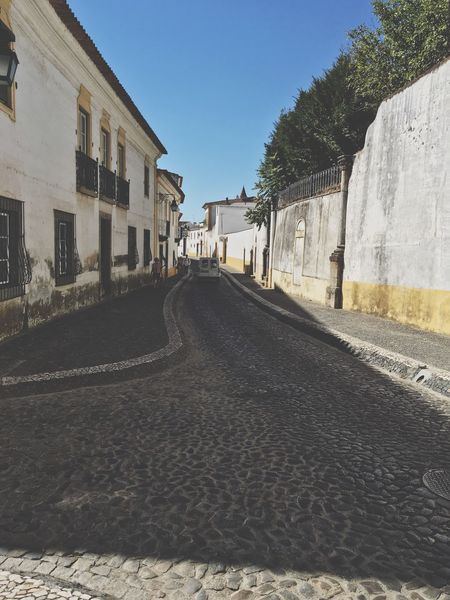 Évora Architecture Built Structure Building Exterior Street Road The Way Forward Clear Sky Empty House Transportation Empty Road Day Sky Diminishing Perspective Outdoors No People Long Surface Level Footpath