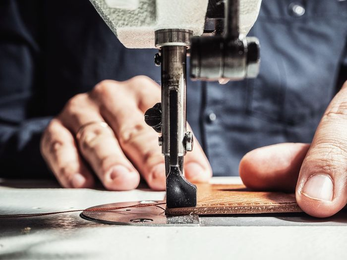 Sewing Leather Hand Handandleather Human Hand Working Occupation Manufacturing Equipment Men Industry Manual Worker Business Finance And Industry Workshop Close-up