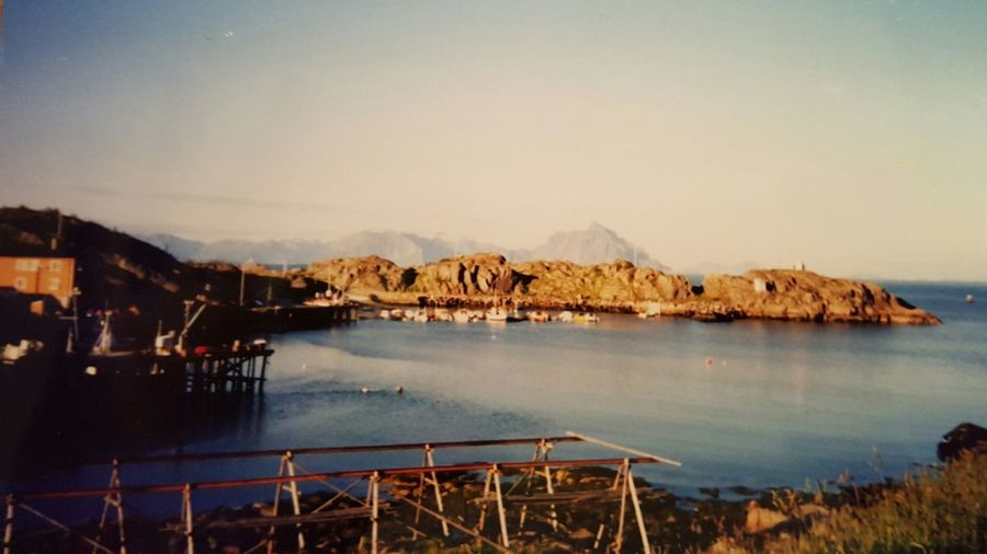 Scenic view of rock formation in sea at lofoten against sky