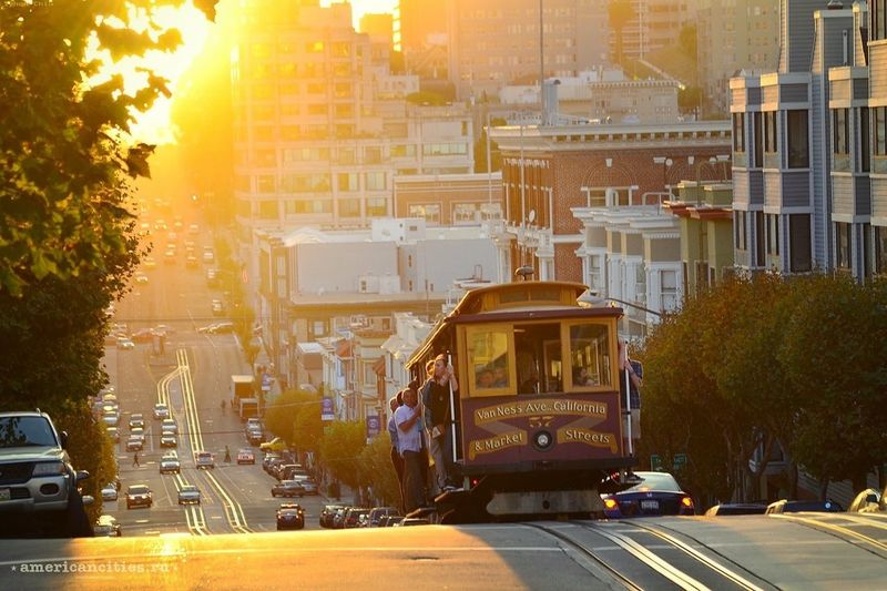 A cable car traveling on Van Ness Ave.