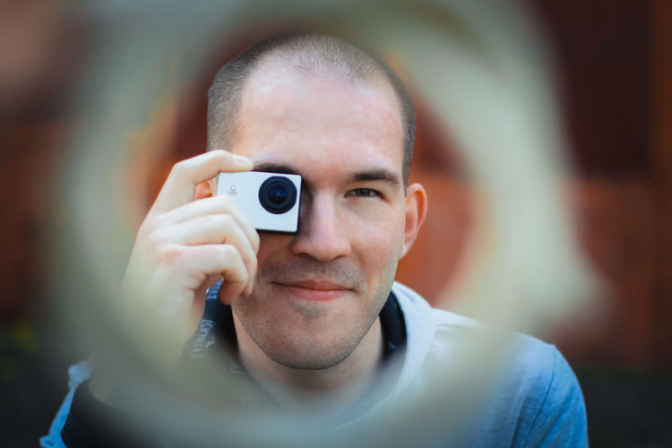 Portrait of happy man photographing