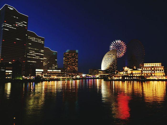 横浜Yokohama Fireworks EyeEm Selects EyeEm Gallery EyeEm City Cityscape Urban Skyline Water Illuminated Modern Skyscraper Ferris Wheel Business Finance And Industry Reflection