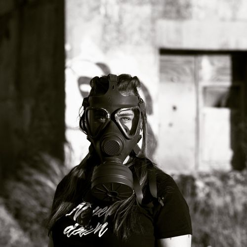 Gas Mask One Person Danger People Day Outdoors Arts Culture And Entertainment Front View Tranquility One Woman Only Only Women Long Hair Eyeglasses  Adult Adults Only Dark Dark Photography