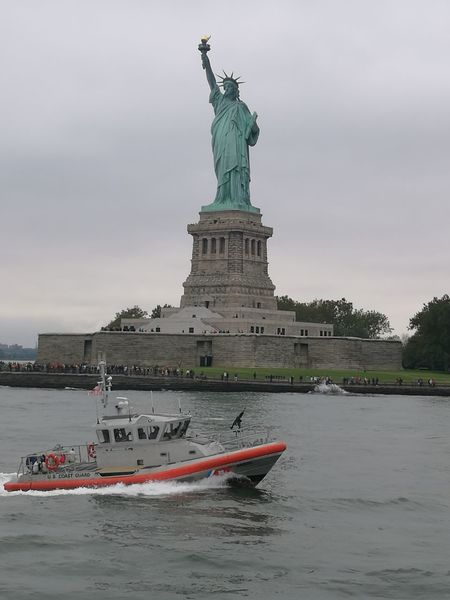Liberty Island Ferry Statue Travel Destinations Architecture Sky Cloud - Sky Water Sea Freedom Outdoors Built Structure No People City Day