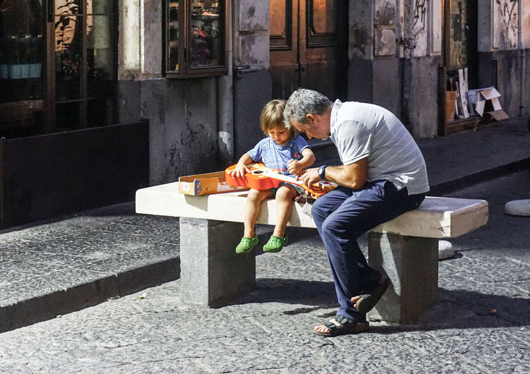 first time playing the guitar Child Childhood Togetherness Family Parent Learning Guitar Street Streetphotography Street Photography Catania Sicily Beginner Father First Time