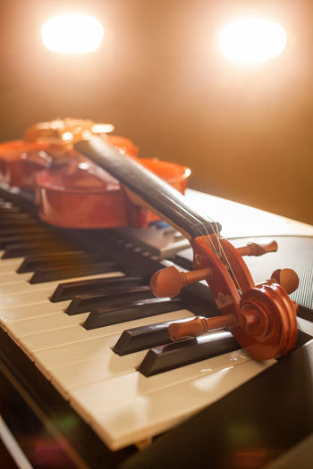 Close-up of piano on table