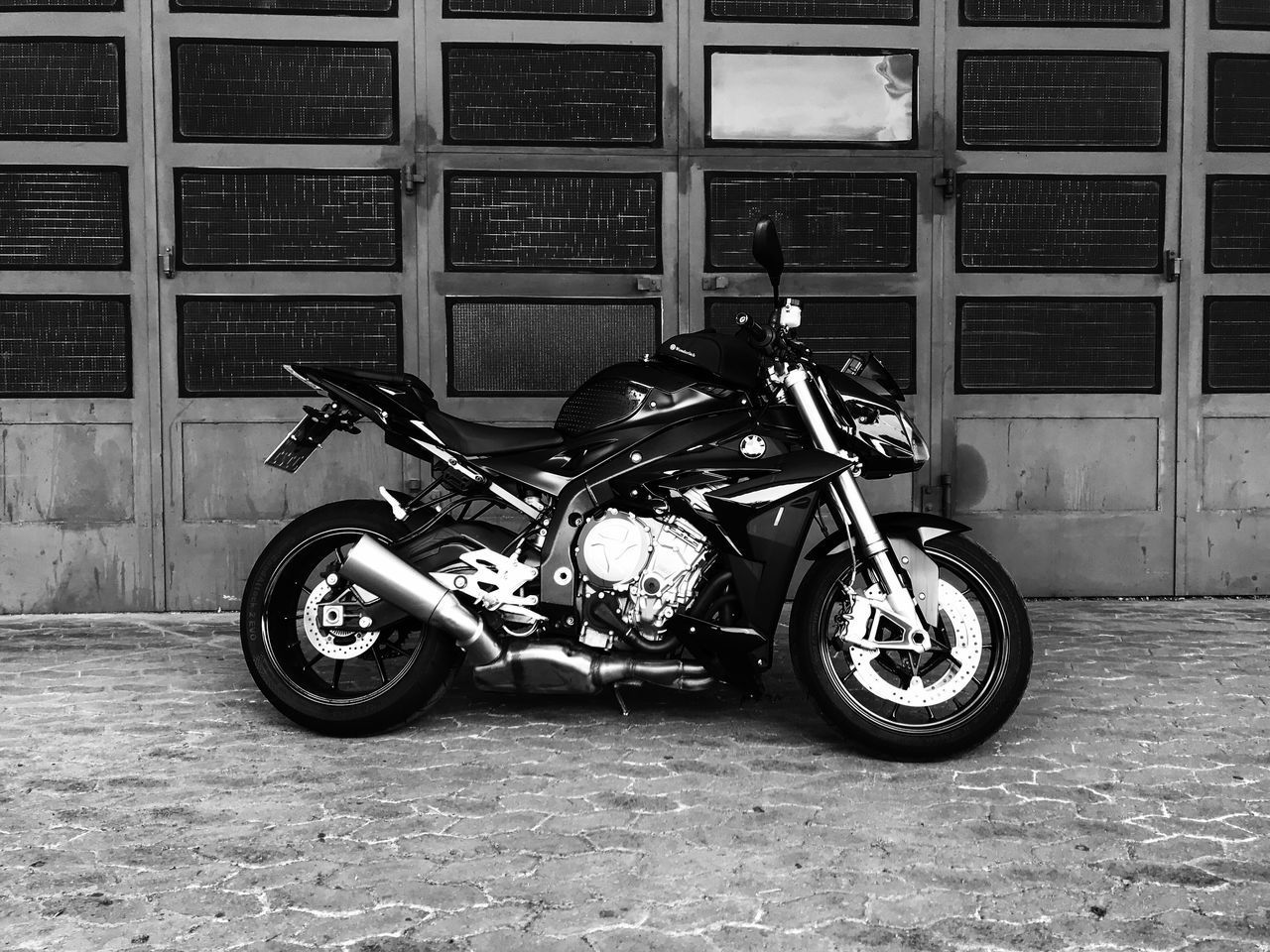 transportation, mode of transportation, land vehicle, motorcycle, architecture, building exterior, built structure, stationary, city, street, day, building, no people, outdoors, parking, window, brick, full length, scooter, luxury