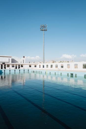 View of swimming pool against buildings