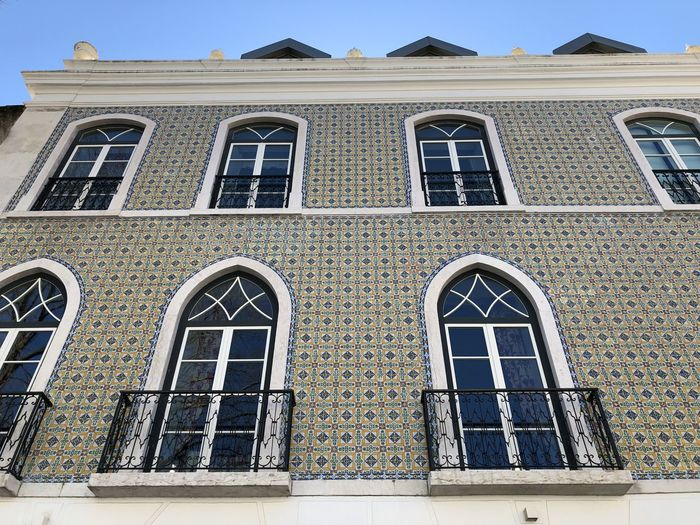 Tiled building in Lisbon, Portugal Lisbon Portugal Architecture Built Structure Building Exterior Building No People Day Window Outdoors Low Angle View Arch Sky Glass - Material Nature City Sunlight The Past History Blue Façade Glass Tile Ceramic Tiled