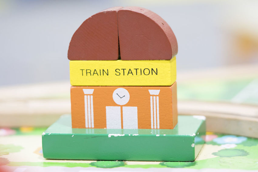 Train Station Wooden Toy Set and Street Signs Play set Educational toys for preschool indoor playground Wooden Toys Wooden Toy Block Focus On Foreground Text Close-up No People Communication Still Life Selective Focus Green Color Nature Orange Color Table Yellow Multi Colored Land Container Wood - Material