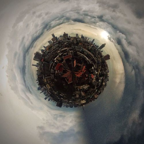 Little planet image of cityscape against cloudy sky during sunset