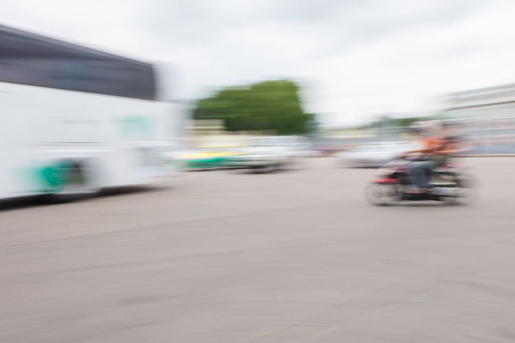 Blurred motion of cars on road against sky