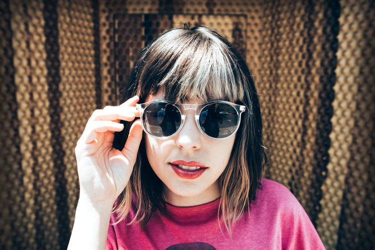 Adult Adults Only Bangs Beautiful Woman Childhood Close-up Day Focus On Foreground Front View Headshot Looking At Camera One Person Outdoors People Portrait Real People Sunglasses Young Adult