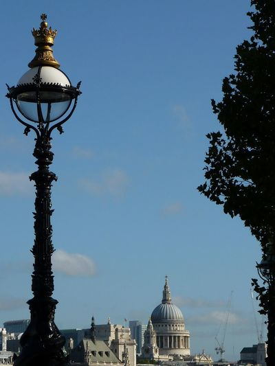 Low angle view of st paul's, cathedral london against blue sky