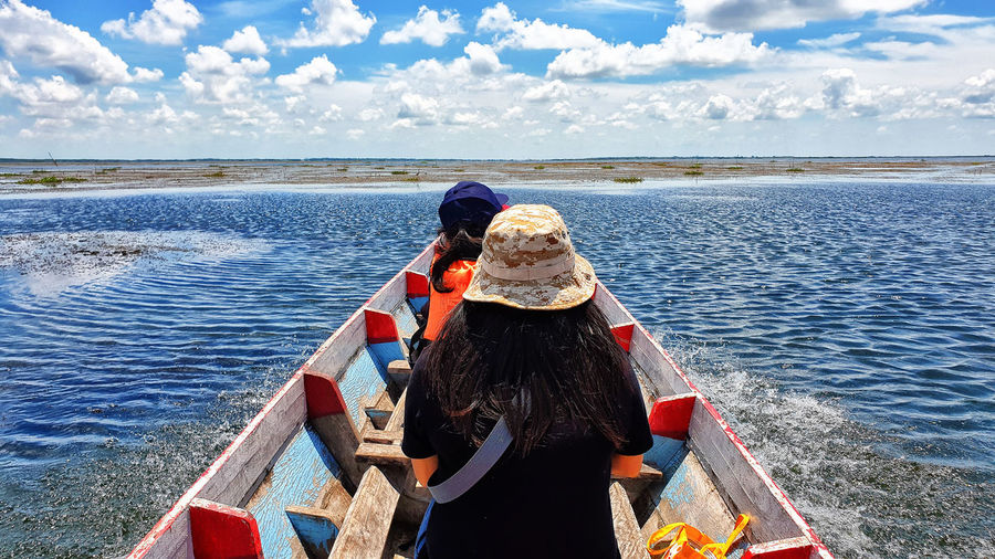 Tourists At Thalay Noi People Transportation Horizon Over Water Adventure WoodenBoat Boat Blue Sky Blue Waterfowl Thailand Phatthalung Thalaynoi Outdoors Women Adult Day Nature Leisure Activity Lifestyles Real People Water Cloud - Sky Sky Rear View Lagoon