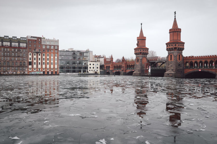 oberbaumbridge over spree river in Berlin city Berlin Berlin City Berlin Friedrichshain Cityscape Ice On The Water Oberbaumbrücke Sights & Views  Sightseeing Sightseeing Spot Winter Architecture Berlin Kreuzberg Berlinstagram Building Exterior Built Structure City Cityscape Cloud - Sky Day Germany No People Oberbaumbridge Outdoors Sky Urban Icon Water Waterfront