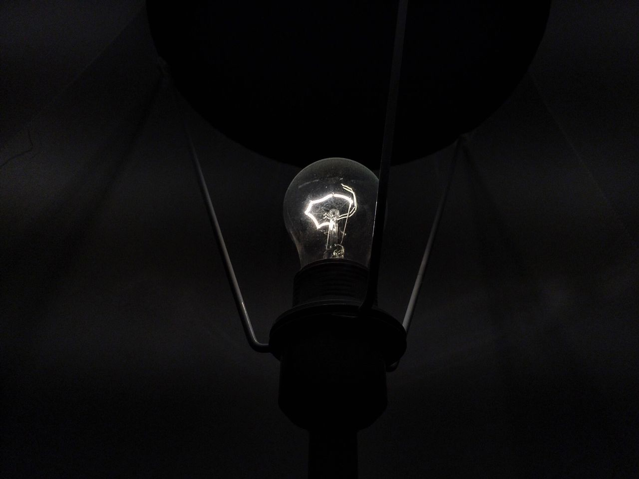 electricity, light bulb, lighting equipment, illuminated, bulb, technology, filament, no people, low angle view, fuel and power generation, close-up, hanging, studio shot, black background, indoors