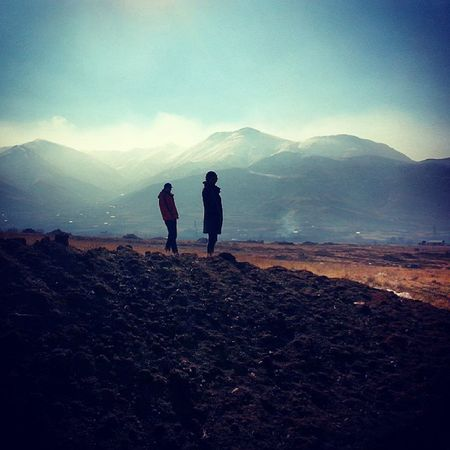 Strangers in Nature Looking Onfoot mountainslandscape