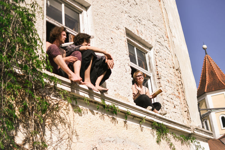 Hippie Architecture Building Exterior Built Structure Group Of People Young Adult Adult Emotion Men Women Togetherness Day Low Angle View Full Length Happiness Young Men Males  Building People Positive Emotion Mature Men Outdoors