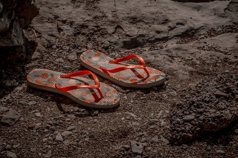 High angle view of shoes on rock