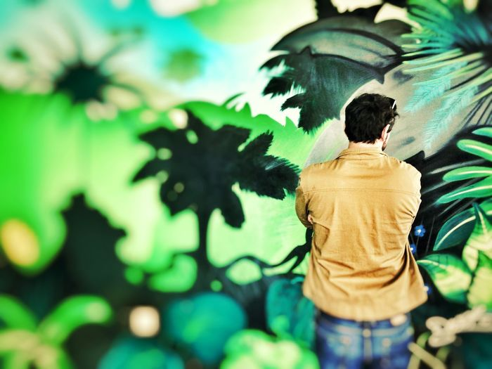Admiring the view Streetphotography Street Art One Person Rear View Real People Day Lifestyles Casual Clothing Standing Plant Tree Waist Up Green Color