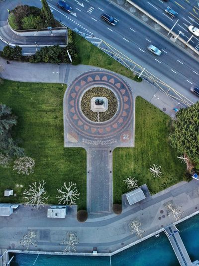 Top down view of Monument National Geneve Monument National DJI X Eyeem DJI Mavic Air Drone Photograph Jardin Anglais Aerial Day High Angle View Water No People Plant Architecture Nature City Motion Outdoors Shape Communication Fountain Wet Building Exterior Park Built Structure Blue Tree