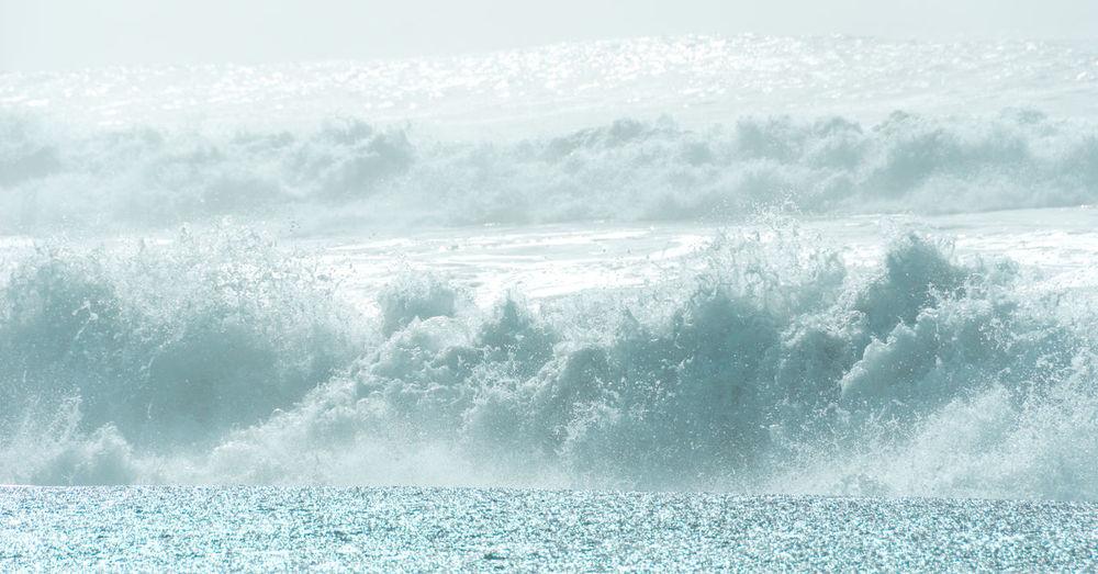 Idyllic shot of waves splashing in sea
