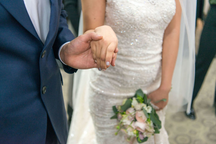 Wedding Bride Newlywed Life Events Wedding Dress Married Love Event Flower Bridegroom Togetherness Celebration Adult Midsection Women Positive Emotion Flowering Plant Two People Beginnings Well-dressed Flower Arrangement Couple - Relationship Bouquet Wedding Ceremony Wife
