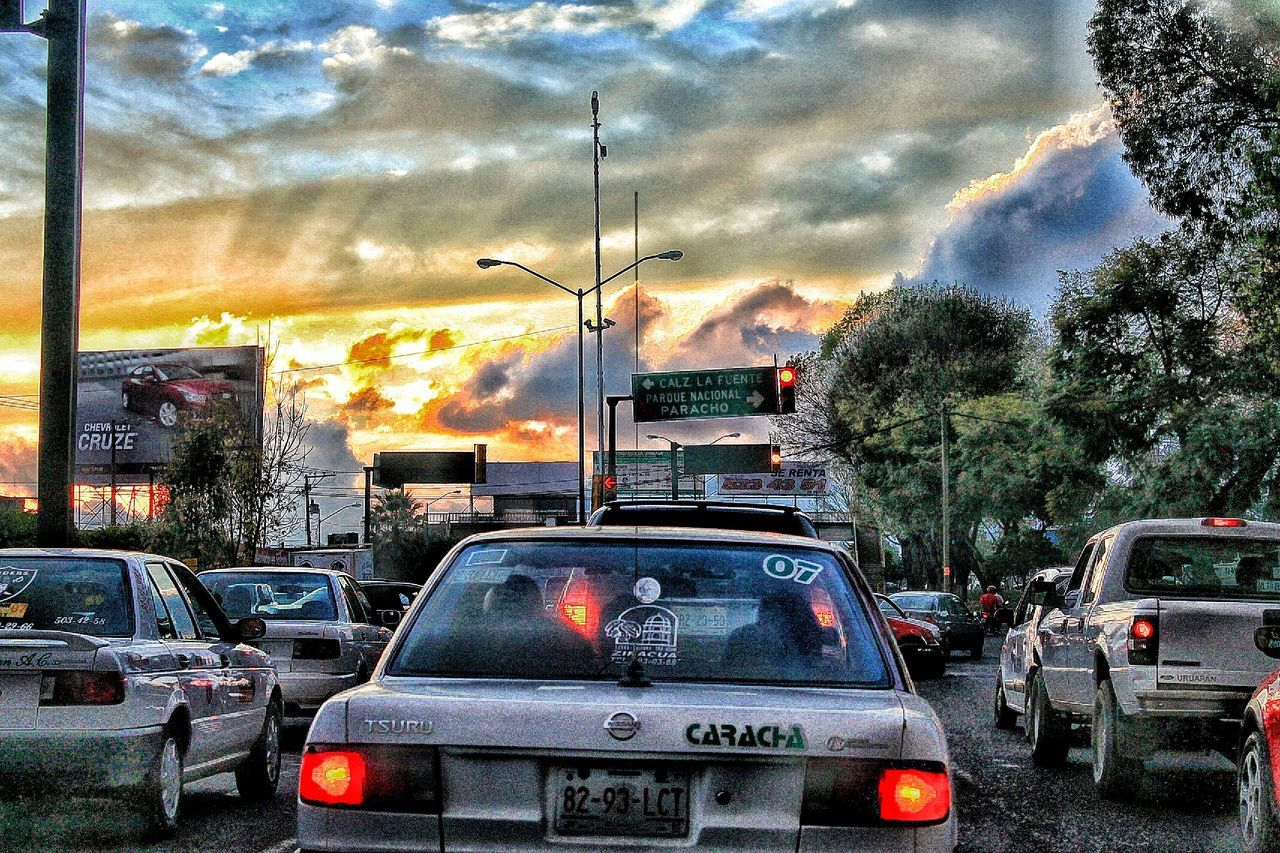 car, cloud - sky, land vehicle, sky, transportation, mode of transport, outdoors, no people, built structure, road, architecture, building exterior, tree, city, storm cloud, day