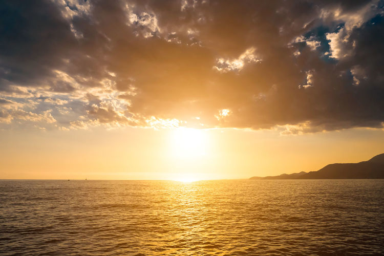 Beach Beauty In Nature Day Dramatic Sky Gold Colored Horizon Over Water Landscape Nature No People Outdoors Scenics Sea Sky Summer Sun Sunbeam Sunlight Sunset Tropical Climate Water
