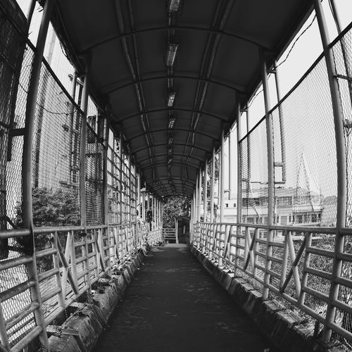 Street Photography Black And White Black And White Photography Street Bridge Architecture Built Structure Corridor Pillar Street Scene Empty Road 17.62° The Art Of Street Photography