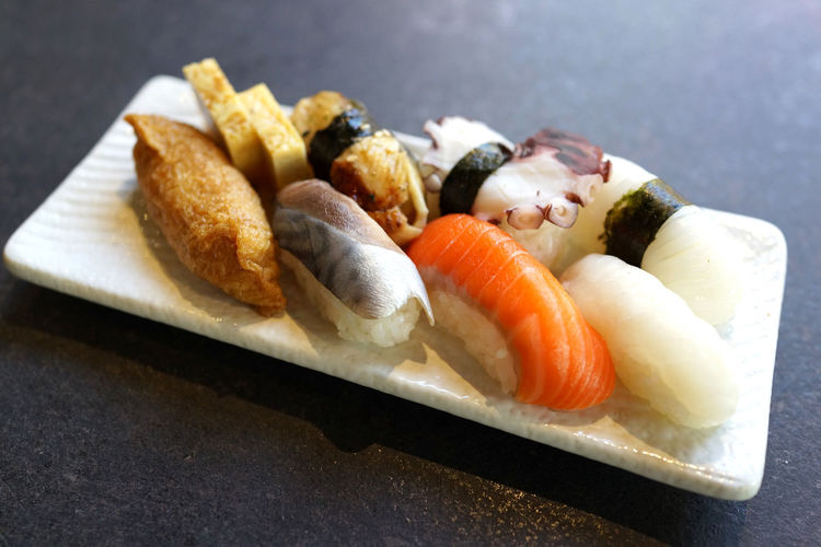 Assorted Japanese sushi on a white plate Food Seafood Freshness Japanese Food Healthy Eating Still Life Ready-to-eat Sushi Wellbeing Close-up No People Plate Indoors  Rice High Angle View Serving Size Focus On Foreground Tray Temptation