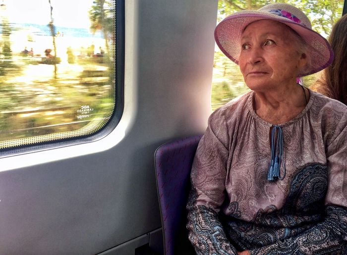 Woman Looking Away While Sitting In Train